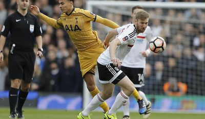 Tottenham Hotspur's Dele Alli, left, and Fulham's Tim Ream challenge for the ball during the English FA Cup soccer match between Fulham and Tottenham Hotspur at Craven Cottage stadium in London, Sunday, Feb. 19, 2017.(AP Photo/Frank Augstein)