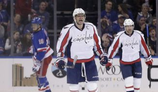 Washington Capitals' Alex Ovechkin, center, reacts after scoring during the second period of an NHL hockey game against the New York Rangers, Sunday, Feb. 19, 2017, in New York. (AP Photo/Seth Wenig)