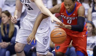 Butler center Nate Fowler (51) tries to make a steal from DePaul guard R.J. Curington (0) in the second half of an NCAA college basketball game in Indianapolis, Sunday, Feb. 19, 2017. (AP Photo/Michael Conroy)