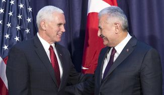"""United States Vice President Mike Pence, left and Turkey's Prime Minister Binali Yildirim, talk prior to their meeting during the Munich Security Conference in Munich, Germany, Saturday, Feb. 18, 2017.  America's commitment to NATO is """"unwavering,"""" Pence said Saturday, reassuring allies about the direction the Trump administration might take but leaving open questions about where Washington saw its relationship with the European Union and other international organizations.  (Prime Minister's Press Service, Pool Photo via AP)"""