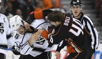 Los Angeles Kings left wing Kyle Clifford, left, and Anaheim Ducks right wing Jared Boll fight during the first period of an NHL hockey game, Sunday, Feb. 19, 2017, in Anaheim, Calif. (AP Photo/Mark J. Terrill)
