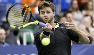 Ryan Harrison, of the United States, returns a shot to Nikoloz Basilashvili in the singles championship at the Memphis Open tennis tournament Sunday, Feb. 19, 2017, in Memphis, Tenn. (AP Photo/Mark Humphrey)