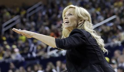 Michigan State head coach Suzy Merchant yells from the sideline during the first half of an NCAA college basketball game against Michigan, Sunday, Feb. 19, 2017, in Ann Arbor, Mich. (AP Photo/Carlos Osorio)