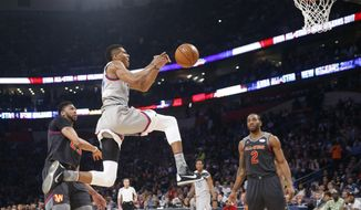 Eastern Conferences forward Giannis Antetokounmpo of the Milwaukee Bucks (34) goes for a layup against Western Conference forward Anthony Davis of the New Orleans Pelicans (23) and Western Conference forward Kawhi Leonard of the San Antonio Spurs (2) during the first half of the NBA All-Star basketball game in New Orleans, Sunday, Feb. 19, 2017. (AP Photo/Gerald Herbert)