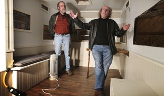 In this Tuesday, Feb. 7, 2017, photo, Tim Cheney, right, and Adrian Hooper, co-founders of Chooper's Guide, a comprehensive addiction treatment program, discuss plans for a trailer they are retrofitting in Walpole, Maine. The mobile unit will provide addiction treatment services to underserved parts of rural Maine. (AP Photo/Robert F. Bukaty)