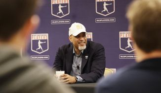 Executive Director of the Major League Players Association Tony Clark answers questions at a news conference Sunday, Feb. 19, 2017, in Phoenix. (AP Photo/Morry Gash)