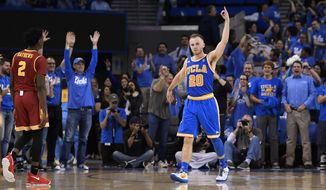 UCLA guard Bryce Alford, right, gestures after hitting a 3-point shot, while Southern California guard Jonah Mathews walks by during the second half of an NCAA college basketball game, Saturday, Feb. 18, 2017, in Los Angeles. UCLA won 102-70. (AP Photo/Mark J. Terrill)