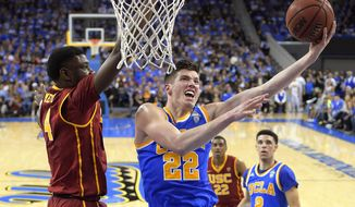 UCLA forward TJ Leaf, right, shoots as Southern California forward Chimezie Metu defends during the first half of an NCAA college basketball game, Saturday, Feb. 18, 2017, in Los Angeles. (AP Photo/Mark J. Terrill)