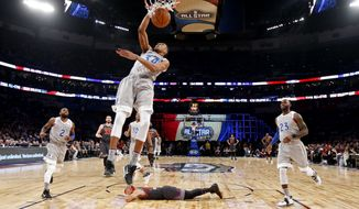 Eastern Conference small forward Giannis Antetokounmpo of the Milwaukee Bucks (34) slam dunks as Western Conference guard Stephen Curry of the Golden State Warriors (30) lies on the court during the first half of the NBA All-Star basketball game in New Orleans, Sunday, Feb. 19, 2017. (AP Photo/Max Becherer, Pool)