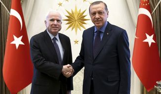 Turkey's President Recep Tayyip Erdogan, right, and U. S. Sen. John McCain, R-Ariz., shake hands prior to a meeting in Ankara, Turkey, Monday, Feb. 20, 2017. McCain met Erdogan after attiendng the Munich Security Conference 2017 in Munich, Germany. (Kayhan Ozer/Presidential Press Service, Pool via AP)