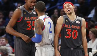 Western Conference guard Stephen Curry of the Golden State Warriors (30) laughs with forward Kevin Durant of the Golden State Warriors (35) and Eastern Conference guard Kyrie Irving of the Cleveland Cavaliers (2) in the second half of the NBA All-Star basketball game in New Orleans, Sunday, Feb. 19, 2017. (AP Photo/Max Becherer)