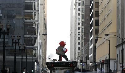 In this Monday, Feb. 6, 2017, photo the Chicago Bulls' mascot Benny the Bull reenacts the famous scene of Ferris Bueller singing during a parade at Daley Plaza while shooting a daylong Snapchat video, reenacting several scenes from the Chicago based movie Ferris Bueller's Day Off, in Chicago. The NBA, including team and player accounts, has about 1.3 billion likes and followers over various social media platforms. The Bulls rank second to the Los Angeles Lakers among major North American sports franchises with 23 million social media followers. (AP Photo/Charles Rex Arbogast)