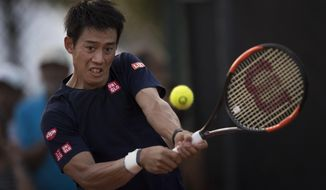 Japan's Kei Nishikori returns the ball during a practice session of the Rio Open tennis tournament in Rio de Janeiro, Brazil, Monday, Feb. 20, 2017. (AP Photo/Felipe Dana)