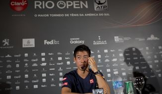 Japan's Kei Nishikori listens to a question during a press conference at the Rio Open tennis tournament in Rio de Janeiro, Brazil, Monday, Feb. 20, 2017. (AP Photo/Silvia Izquierdo)