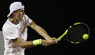 Belgium's Arthur De Greef returns the ball to Pablo Cuevas of Uruguay, at the Rio Open tennis tournament in Rio de Janeiro, Brazil, Monday, Feb. 20, 2017. (AP Photo/Felipe Dana)