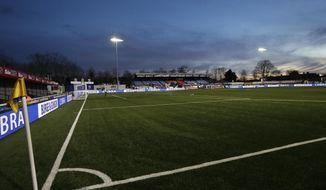 Lights illuminate the pitch ahead of the English FA Cup fifth round soccer match between Arsenal and Sutton United at Gander Green Lane stadium in London, Monday, Feb. 20, 2017. (AP Photo/Matt Dunham)