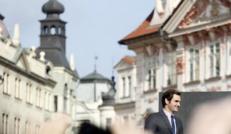Switzerland's tennis player Roger Federer arrives to greet his fans at the Old Town Square in Prague, Czech Republic, Monday, Feb. 20, 2017. Federer arrived in Prague to promote the Laver Cup, a tournament that will be held in Prague on Sept. 22 to24, 2017, pitting six top European players against their counterparts from the rest of the world. (AP Photo/Petr David Josek)