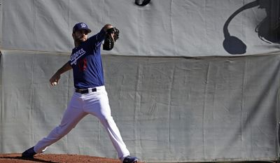 Los Angeles Dodgers' Brandon Morrow throws during a spring training baseball workout Tuesday, Feb. 14, 2017, in Glendale, Ariz. (AP Photo/Morry Gash)