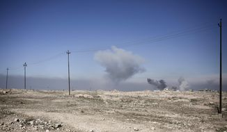 Smoke rises from the town of Abu Saif after air strikes hit Islamic State militant positions, Monday, Feb. 20, 2017. Iraqi federal police units continued their advance towards western Mosul on Monday, battling Islamic State militants at a strategic hill south of the city's airport. (AP Photo/Bram Janssen)