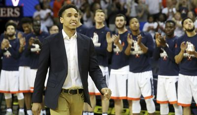 Malcolm Brogdon is introduced during a ceremony to retire his number before the start of an NCAA college basketball game against Miami, Monday, Feb. 20, 2017, in Charlottesville, Va. (AP Photo/Ryan M. Kelly)