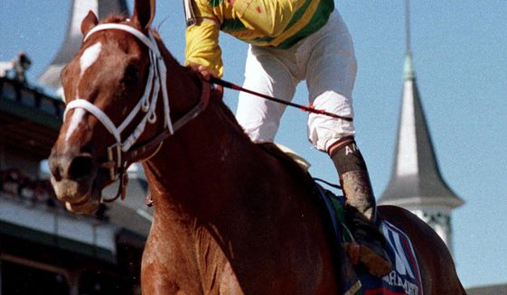 FILE - In this May 1, 1999, file photo, jockey Chris Antley gestures aboard Charismatic after crossing the finish line to capture the 125th running of the Kentucky Derby in Louisville, Ky. Former Kentucky Derby and Preakness Stakes winner Charismatic has died at a thoroughbred retirement farm in Kentucky. Old Friends farm says the chestnut horse that won the first two legs of the Triple Crown in 1999 was found dead in his stall Sunday, Feb. 19, 2017. (AP Photo/Al Berhman, File)
