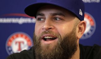 FILE - In this Feb. 16, 2017, file photo, Mike Napoli talks to the media during a news conference at spring training baseball practice in Surprise, Ariz. Jurickson Profar and Ryan Rua went into the offseason expecting to split more time at first base this season. Now they're back in the outfield, and a healthy Shin-Soo Choo may be the designated hitter more often than he wants. A lot changed when Mike Napoli rejoined the Texas Rangers. (AP Photo/Charlie Riedel, File)