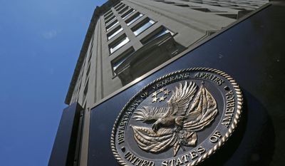 FILE - In this June 21, 2013 file photo, the Veterans Affairs Department in Washington. Federal authorities are stepping up investigations at Department of Veterans Affairs medical centers due to a sharp increase in opioid theft, missing prescriptions or unauthorized drug use by VA employees since 2009, according to government data obtained by The Associated Press. (AP Photo/Charles Dharapak, File)