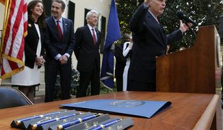Virginia Gov. Terry McAuliffe, right, speaks before vetoing House Bill 2264, which would restrict state and federal funding for women's health providers like Planned Parenthood, as , from left, first lady Dorothy McAuliffe, Lt. Gov. Ralph Northam and Attorney Gen. Mark Herring, look on in a ceremony outside the executive mansion in Richmond, Va., Tuesday, Feb. 21, 2017. (Bob Brown/Richmond Times-Dispatch via AP)