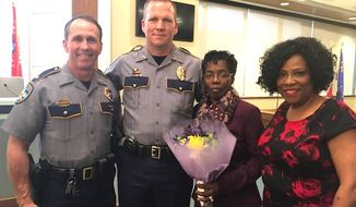 Vickie Williams-Tillman (second from right), is flanked by Baton Rouge Police Department Chief Carl Dabadie (left), Cpl. Billy Aime and Mayor-president Sharon Weston Broome on Feb. 20, after she was recognized for aiding Aime during an altercation with another motorist. (The City of Baton Rouge via Facebook)