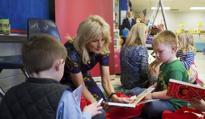 In this Feb. 15, 2017 photo provided by Save the Children, Dr. Jill Biden speaks with students Gus Mathis, right, and Cole Swindle, during Biden's visit with Save the Children at Linden Elementary School in Linden, Tenn. Biden, educator and wife of former Vice President Joe Biden, was named board chair of Save the Children, which focuses on the health, education and safety of kids, announced Tuesday, Feb. 21, 2017. (Shawn Millsaps/Save the Children via AP)