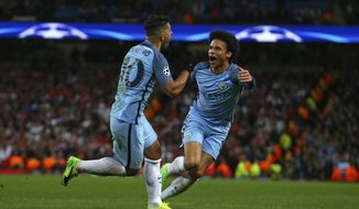 Manchester City's Sergio Aguero, left, celebrates with Leroy Sane after scoring his side's third goal during the Champions League round of 16 first leg soccer match between Manchester City and Monaco at the Etihad Stadium in Manchester, England, Tuesday Feb. 21, 2017. (AP Photo/Dave Thompson)