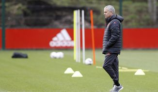 Manchester United manager Jose Mourinho attends a training session at the Aon Training Complex, Manchester, England, Tuesday, Feb. 21, 2017. Manchester United will play Saint-Etienne in a Europa League round of 32 soccer match on Wednesday. (Martin Rickett/PA via AP)