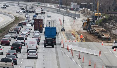 Interstate 15 traffic moves around the closed lane of the southbound in the Cajon Pass, Calif., Monday, Feb. 20, 2017. A portion of the freeway was washed away by flooding last week. (James Quigg/The Daily Press via AP)