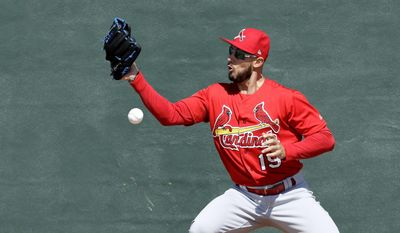 FILE - In this Feb. 17, 2017 file photo, St. Louis Cardinals' Jordan Schafer tries to catch a ball as part of a drill during a spring training baseball workout in Jupiter, Fla.  Three times this camp Schafer has taken his mid-90s fastball to the mound, twice for scheduled bullpen sessions and once for live batting practice. On days in between, Schafer participated in pitchers fielding practice and the normal side work expected of a reliever before heading to outfield drills and picking up a bat.(AP Photo/David J. Phillip)