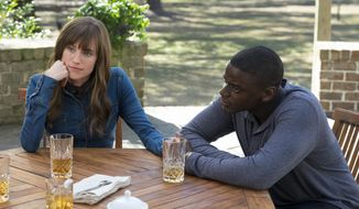 "Allison Williams, left, and Daniel Kaluuya take part in a scene from ""Get Out."" (Justin Lubin/Universal Pictures via AP)"