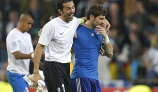 FILE - This Oct. 23, 2013 file photo shows Juventus goalkeeper Gianluigi Buffon, left, sharing a laugh with then Real Madrid goalkeeper Iker Casillas at the end of a Group B Champions League soccer match between Real Madrid and Juventus at the Santiago Bernabeu stadium in Madrid, Spain. It will be a meeting of goalkeeping greats when Gianluigi Buffon faces old rival Iker Casillas in the Champions League on Wednesday, Feb. 22, 2017 as Juventus visits Porto. (AP Photo/Paul White, file)