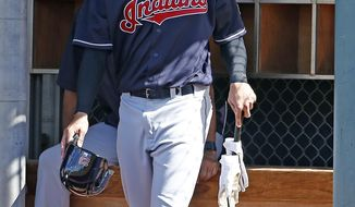 Cleveland Indians' Michael Brantley gets ready to bat at the team's baseball spring training facility Monday, Feb. 20, 2017, in Goodyear, Ariz. (AP Photo/Ross D. Franklin)