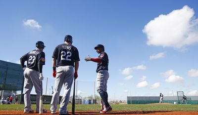 Cleveland Indians' Michael Brantley (23), Jason Kipnis (22) and Francisco Lindor, right, all talk prior to batting at the team's baseball spring training facility Monday, Feb. 20, 2017, in Goodyear, Ariz. (AP Photo/Ross D. Franklin)