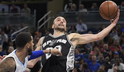 FILE - In this Wednesday, Feb. 15, 2017, file photo, San Antonio Spurs guard Manu Ginobili (20) grabs a rebound in front of Orlando Magic guard D.J. Augustin during the first half of an NBA basketball game in Orlando, Fla. Teams, and the league, try to make the transition to the NBA easier for all players, but internationals need some special attention. Ginobili, the veteran Spurs guard, said he would get lonely at times when he was younger with a lot fewer international players in the league. (AP Photo/Phelan M. Ebenhack, File)