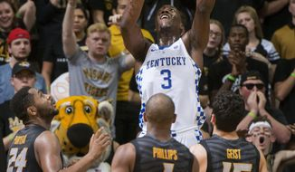 Kentucky's Edrice Adebayo, top, shoots over Missouri's Kevin Puryear, left, Terrence Phillips, center, and Jordan Geist, right, during the first half of an NCAA college basketball game, Tuesday, Feb. 21, 2017, in Columbia, Mo. (AP Photo/L.G. Patterson)