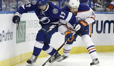 Tampa Bay Lightning left wing Alex Killorn (17) and Edmonton Oilers left wing Anton Slepyshev (42), of Russia, vie for the puck along the boards during the first period of an NHL hockey game Tuesday, Feb. 21, 2017, in Tampa, Fla. (AP Photo/Chris O'Meara)