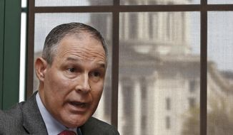 FILE - In this March 10, 2016, file photo, Scott Pruitt, Oklahoma Attorney General, gestures as he speaks during an interview in Oklahoma City. The Oklahoma Capitol is at rear. The Oklahoma attorney general's office says it has complied with a judge's order to surrender documents related to new Environmental Protection Agency leader Pruitt's communications with energy companies. (AP Photo/Sue Ogrocki, File)
