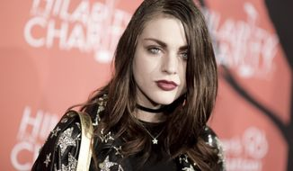 FILE - In this Oct. 15, 2016, file photo, Frances Bean Cobain attends the 5th Annual Hilarity for Charity Variety Show: Seth Rogen's Halloween in Los Angeles. Cobain posted a tribute to her late father Kurt Cobain on what would have been his 50th birthday on Feb. 20, 2017. (Photo by Richard Shotwell/Invision/AP, File)