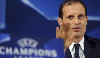 Juventus head coach Massimiliano Allegri gestures during a news conference at the Dragao stadium in Porto, Portugal, Tuesday, Feb. 21, 2017. Juventus will play FC Porto in a Champions League round of 16, first leg, soccer match Wednesday. (AP Photo/Paulo Duarte)