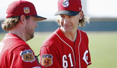 Cincinnati Reds pitcher Bronson Arroyo (61) talks with fellow pitcher Drew Storen, left, at the team's baseball spring training facility Monday, Feb. 20, 2017, in Goodyear, Ariz. (AP Photo/Ross D. Franklin)