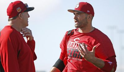 Cincinnati Reds first baseman Joey Votto, right, talks with manager Bryan Price, left, at the team's baseball spring training facility Monday, Feb. 20, 2017, in Goodyear, Ariz. (AP Photo/Ross D. Franklin)