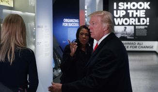 President Donald Trump tours the National Museum of African American History and Culture, Tuesday, Feb. 21, 2017, in Washington. (AP Photo/Evan Vucci)