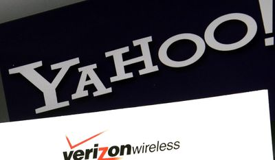 FILE - This Monday, July 25, 2016, file photo shows the Yahoo and Verizon logos on a laptop, in North Andover, Mass.   Yahoo is taking a $350 million hit on its previously announced $4.8 billion sale to Verizon in a concession for security lapses that exposed personal information stored in more than 1 billion Yahoo user accounts.The revised agreement announced Tuesday, Feb. 21, 2017,  eases investor worries that Verizon Communications Inc. would demand a discount of at least $1 billion or cancel the deal entirely.   (AP Photo/Elise Amendola, File)
