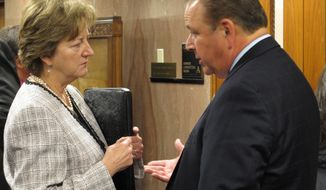 Sen. Sharon Hewitt, R-Slidell, left, talks with House Speaker Taylor Barras, R-New Iberia, ahead of a Senate Finance hearing on legislation that is part of a budget-rebalancing deal in the special session, on Tuesday, Feb. 21, 2017, in Baton Rouge, La. (AP Photo/Melinda Deslatte)