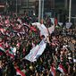Supporters of Syrian President Bashar Assad celebrated a government military victory in Aleppo last month. A common enemy, the Islamic State terrorist group, has created a delicate coalition of U.S., Turkish, Russian and Iranian-backed forces, as well as moderate Sunni Muslim Arab rebels and Kurdish paramilitaries. (Associated Press)